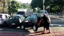 Hulking Cyclist -- Moves Car Out Of Bike Path ... By Picking It Up!!!