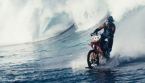 Awesome Surfing Motorbike -- Speeds Across Tahitian Waves