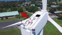 Crazy Sunbather -- Drone Spots Guy Tanning On Windmill!!!