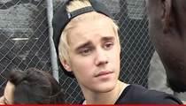 Justin Bieber Off Formal Probation ... He Got His Hands Dirty