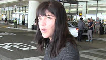 Selma Blair -- Outburst on Flight ... Removed by Stretcher