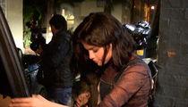 Selena Gomez Tells Paparazzi to Talk to the Hand