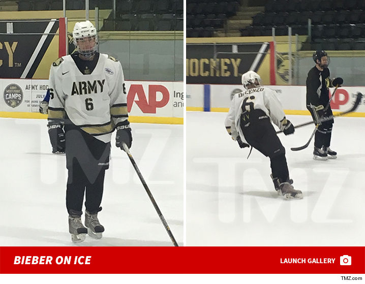 0326-justin-bieber-hockey-army-gallery-launch-TMZ-launch-2